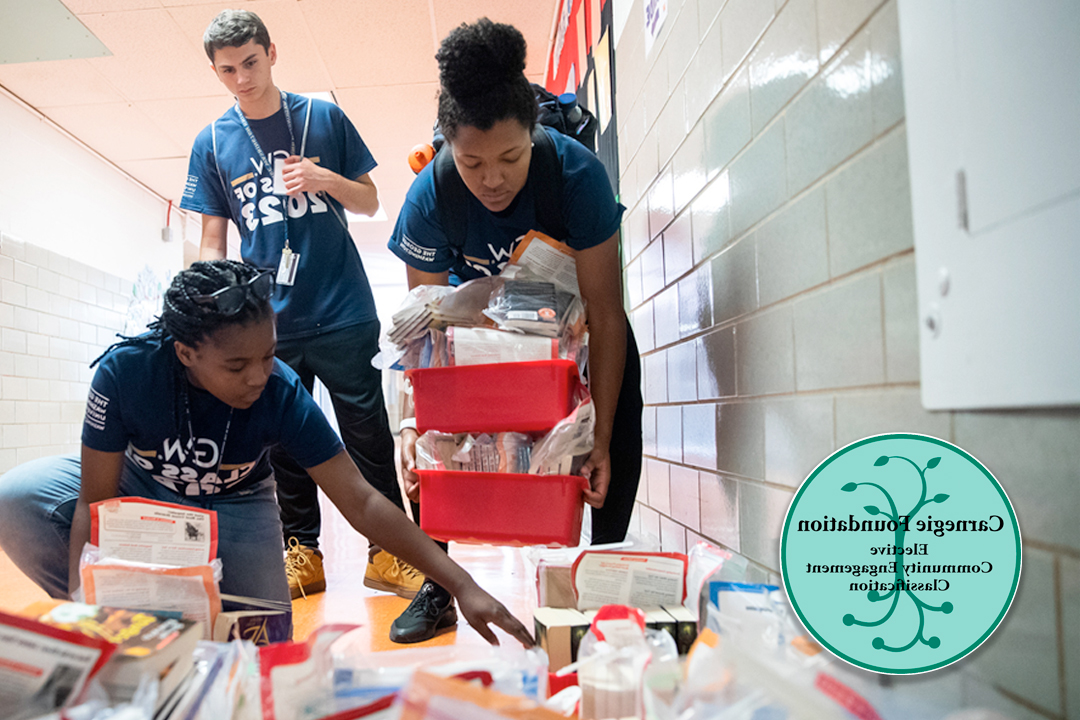 Three student volunteers sorting medical supplies; Carnegie Foundation Elective Community Engagement Classification